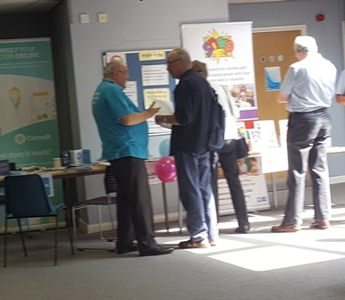 Patients at the Carer's Event speaking with representatives